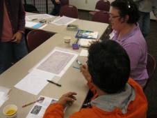 David Sandoval and Leann Hurst discuss ideas on a site map.