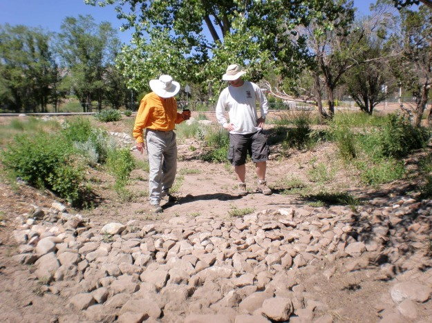 Jim and Dana stand near a soil sponge in the basin.